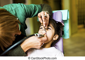Little girl at the dentist
