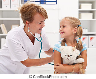 Little girl at the doctor for a checkup examination - Happy...