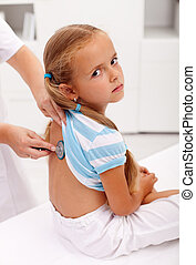 Little girl at the doctor for an examination