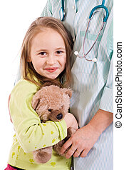 Little girl at the doctors - studio shot - isolated
