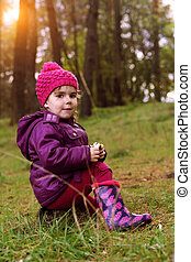 little girl at the forest