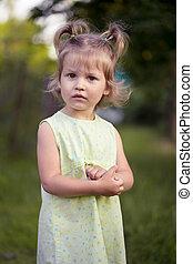 little girl at the garden