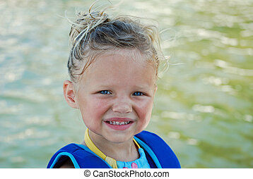 Little girl at the lake