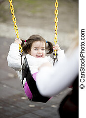 Little girl at the swing