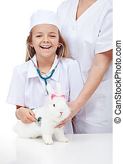 Little girl at the veterinary with her rabbit