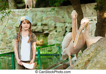 Little girl at the zoo