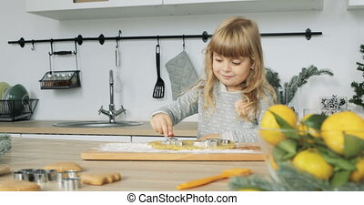 Little girl baking. cute little daughter prepare Christmas cookies