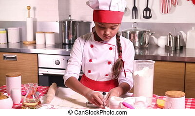 Little girl baking in the kitchen at home - Little girl in...