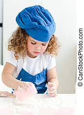 Little girl baking in the kitchen
