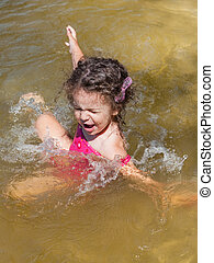 Little girl bathes in the river
