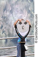 little girl behind scope