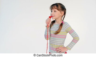 Little girl blowing a whistle, locked down real time video