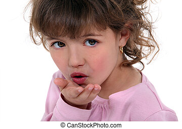 Little girl blowing kiss