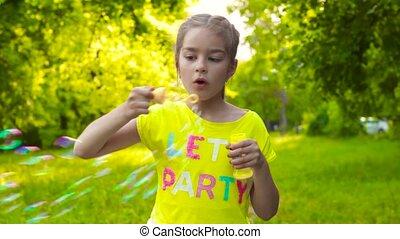 Little girl blowing soap bubbles - Pretty little girl...