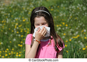 Little girl blows her nose with handkerchief