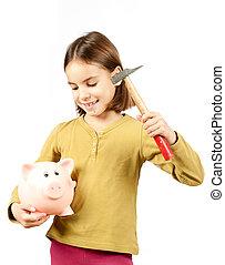 little girl breaking a piggy bank