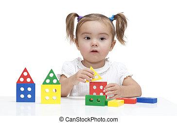 Little girl build a town