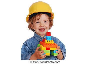 little girl builder with toy block house