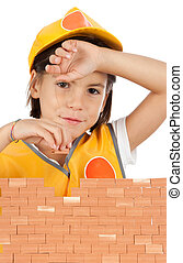 little girl building a wall isolated on white background