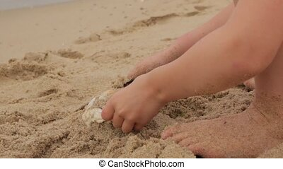 Little Girl Builds A Sand Castle
