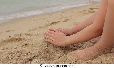 Little Girl Builds Sand Castle