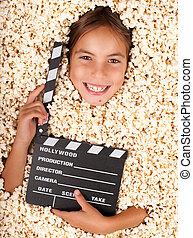 little girl buried in popcorn