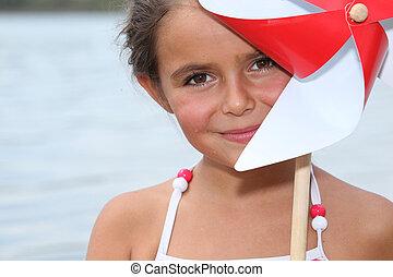 little girl by riverside