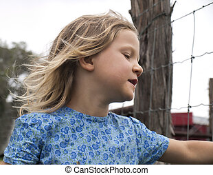 Little Girl by the Fence