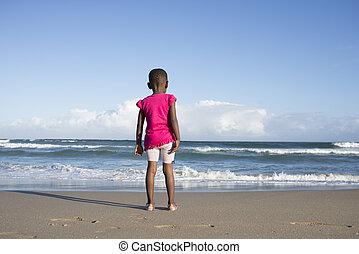Little Girl by the Ocean on the Beach