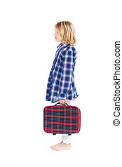 Little girl carrying a suitcase