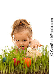 Little girl catching the Easter chicken