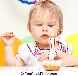 Little girl celebrating first birthday