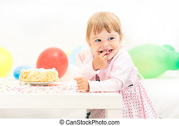 Little girl celebrating second birthday - Little girl...