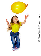 Little girl chasing balloon on white background