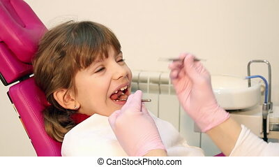 little girl checks teeth