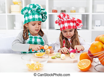 Little girl chefs in the kitchen
