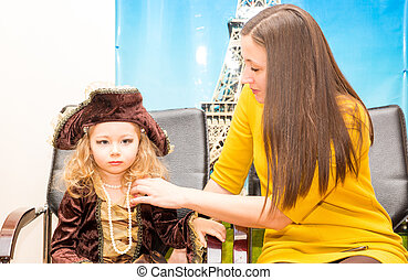 Little girl child dressed as pirate for Halloween with mom