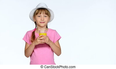 Little girl child drinking orange juice over white