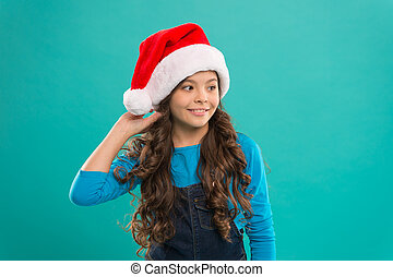 Little girl child in santa hat. Present for Xmas. Childhood. New year party. Santa claus kid. Happy winter holidays. Small girl. Christmas shopping. Are you ready. New 2019 Year is coming
