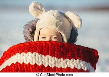 Little girl child sitting on sledges