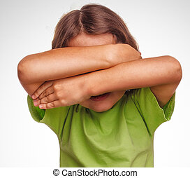 little girl child teenager covering her face isolated on white background gray