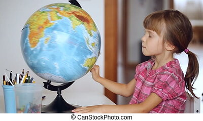 Little girl choosing location of the next vacation