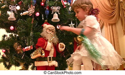 little girl, christmas tree and Santa - Little girl,...