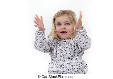 Little girl clapping