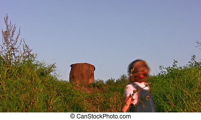 little girl climb on stump - Little girl climb on stump