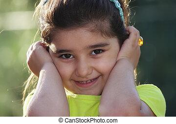 Little girl closing ears