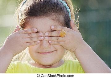 Little girl closing eyes
