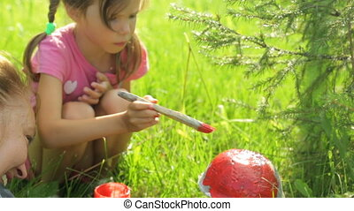 Little girl coloring garden decoration