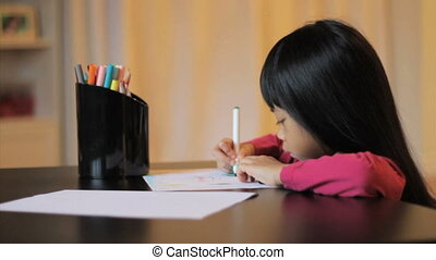 Little Girl Coloring With A Marker