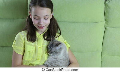 Little girl communicates with her beloved cat. - Beautiful...